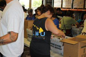 HOWU member Sui Ling Poy helped to sort donated food item.