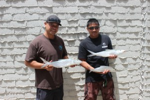 Unit 4412 - Servco Pacific anglers with their catch (l-r): Jerry Lactaoen with an oio and Arnold Fejeder with his two oio.